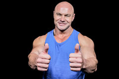 Smiling healthy man showing thumbs up Royalty Free Stock Images
