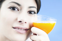 Smiling at the healthy orange juice Stock Photography