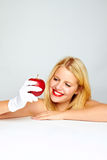 Smiling healthy woman with apple Royalty Free Stock Image