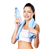 Smiling healthy woman with  bottle of water Royalty Free Stock Photos