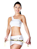Smiling healthy woman after dieting measures hip. Healthy lifestyle Stock Images