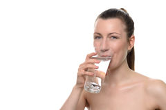 Smiling Healthy Woman Drinking a Glass of Water Royalty Free Stock Photography