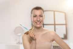 Smiling healthy woman holding a toothbrush Royalty Free Stock Photo