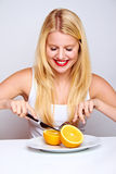 Smiling healthy woman with orange Stock Image