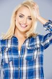 Smiling healthy young blond woman Stock Images