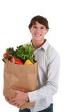 Smiling Healthy Young Man Holding Groceries Bag Stock Photography