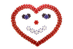 Smiling heart. Creative poker chips, smiling heart made of red blue black and white poker chips isolated over white Royalty Free Stock Photo