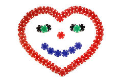 Smiling heart. Creative poker chips, smiling heart made of red blue black and white poker chips isolated over white Stock Photography