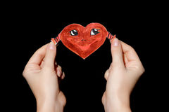 Smiling heart in hands Royalty Free Stock Image