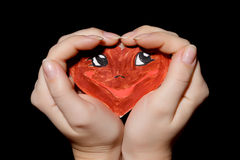 Smiling heart in hands Stock Photo