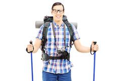Smiling hiker with backpack and hiking poles posing Stock Images