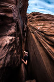 Smiling Hiker in Crack in the Wall Escalante Utah USA Royalty Free Stock Image