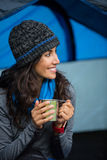 Smiling hiker having a cup of coffee in tent Royalty Free Stock Image