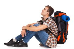 Smiling hiker sitting with knapsack Royalty Free Stock Images