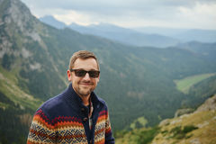 Smiling Hiker Standing In Front Of A Majestic Mountain Landscape Stock Photos