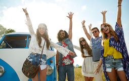 Smiling hippie friends having fun over minivan car stock photos