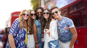 Smiling hippie friends with selfie stick in london Royalty Free Stock Images
