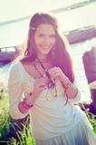 Smiling hippie girl. In locking light Stock Photo