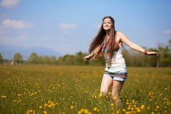 Smiling hippie in summer flowers field Royalty Free Stock Photography