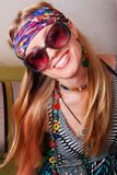 Smiling hippie in sunglasses. Smiling girl in sunglasses with the emblem of the hippy Stock Photography