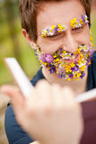 Smiling hippy hipster reading face flower-covered Stock Image