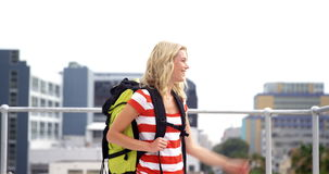 Smiling hipster with backpack visiting a city stock footage