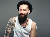 Smiling Hipster boy.handsome man in hat royalty free stock photography