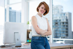 Smiling hipster business woman with her arms crossed Stock Image