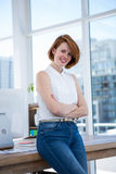 smiling hipster business woman with her arms crossed Stock Photos