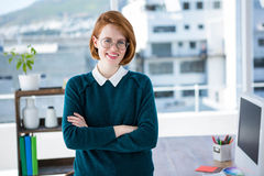 smiling hipster business woman with her arms crossed Stock Images