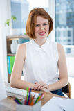 smiling hipster business woman with her hands on the desk Royalty Free Stock Photography