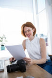 smiling hipster business woman reading files Royalty Free Stock Photography