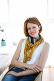 smiling hipster business woman sitting at her desk Stock Images