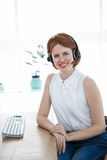 smiling hipster business woman wearing a headset Royalty Free Stock Image