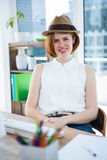 Smiling hipster business woman wearing a trilby Stock Photos