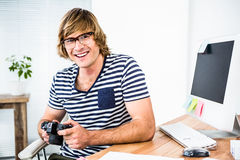 Smiling hipster businessman checking photo on camera Royalty Free Stock Photography