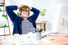 Smiling hipster businessman takes a break Royalty Free Stock Photos