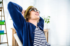 Smiling hipster businessman takes a break Stock Photography