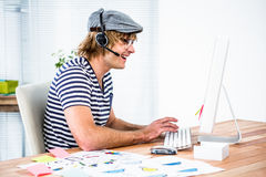 Smiling hipster businessman using headset Royalty Free Stock Photo
