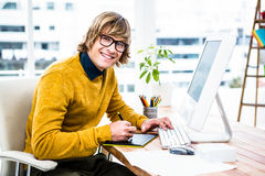 Smiling hipster businessman using tablet graphic Royalty Free Stock Photos