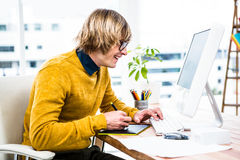 Smiling hipster businessman using tablet graphic Stock Image