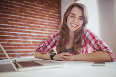 Smiling hipster businesswoman looking at the camera Royalty Free Stock Photo