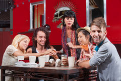 Smiling Hipster with Friends Eating Stock Images