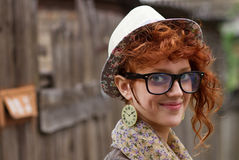 Smiling hipster girl. Positive young person in vintage hat and eyeglasses Royalty Free Stock Photos