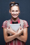 Smiling hipster girl holding tablet PC royalty free stock photo