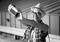 Smiling hipster girl making selfie on vintage film camera Stock Photos