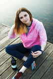 Smiling hipster girl on pier Stock Photography