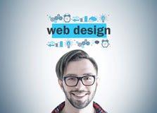 Smiling hipster guy in glasses, web design stock photo