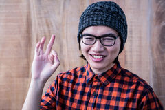 Smiling hipster making ok sign Stock Images