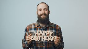 Hipster man showing and giving you a Happy Birthday text. Smiling hipster man showing and giving you a Happy Birthday text stock video